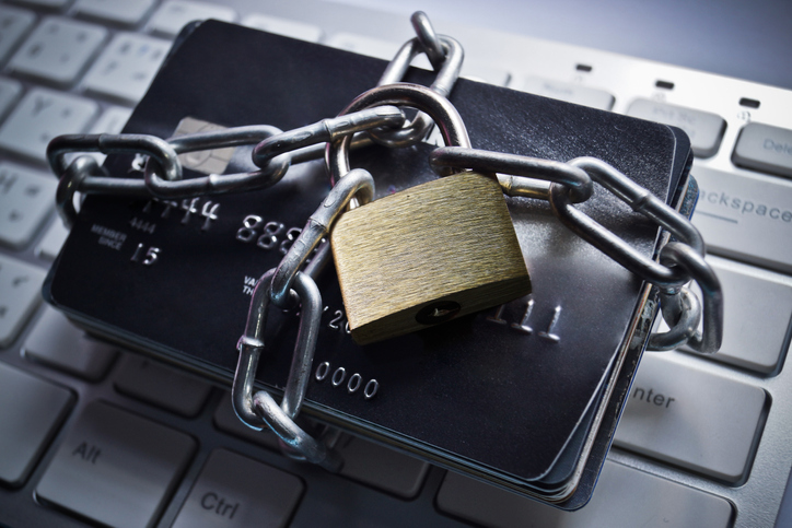 Image of credit cards locked down with a chain and padlock.