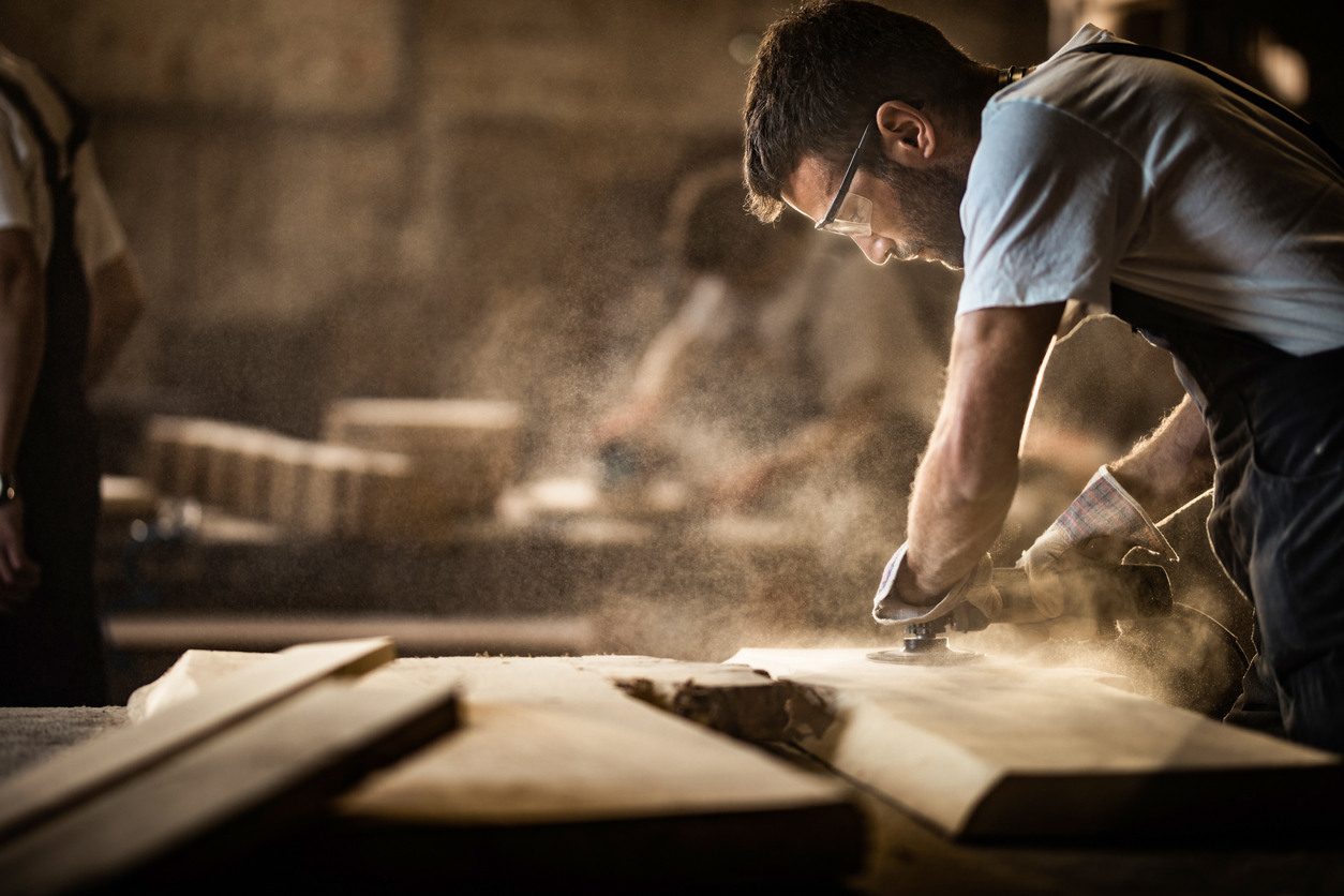 Image of man woodworking.